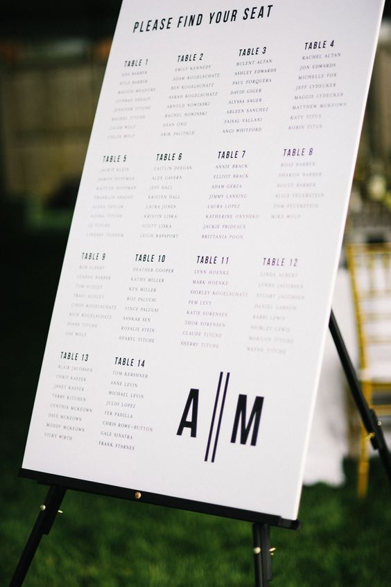 a simple printable black and white seating chart on a astand i enough for a modern wedding