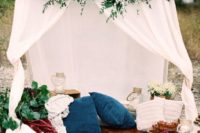 25 a teepee with lush florals and gorgeous textiles instead of a sweetheart table