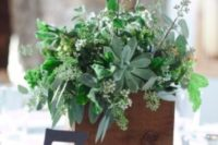 25 a wooden box with lots of greenery and pale scculents for a spring wedding