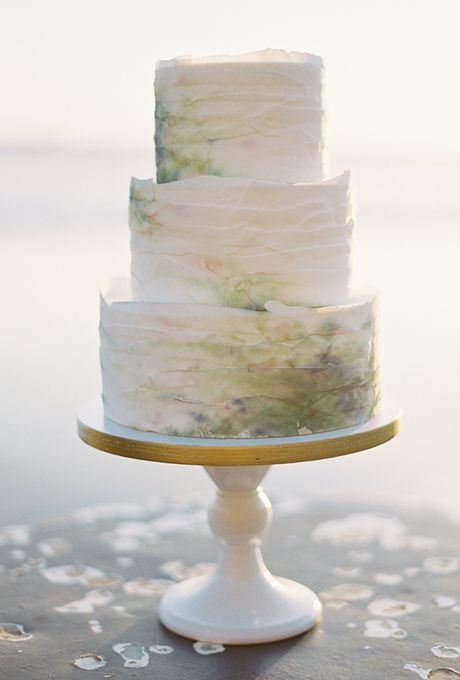 abstract, ethereal watercolor stains on a white texured cake for a unique spring-inspired look