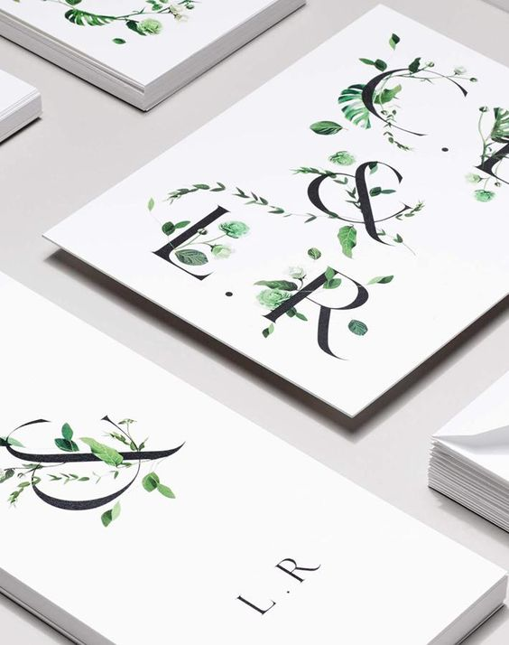 minimalist wedding invitations with botanical prints to give them a spring touch