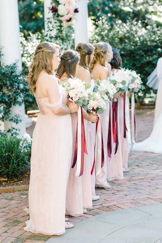 off the shoulder blush gowns with blush and cream bouquets and marsala ribbons