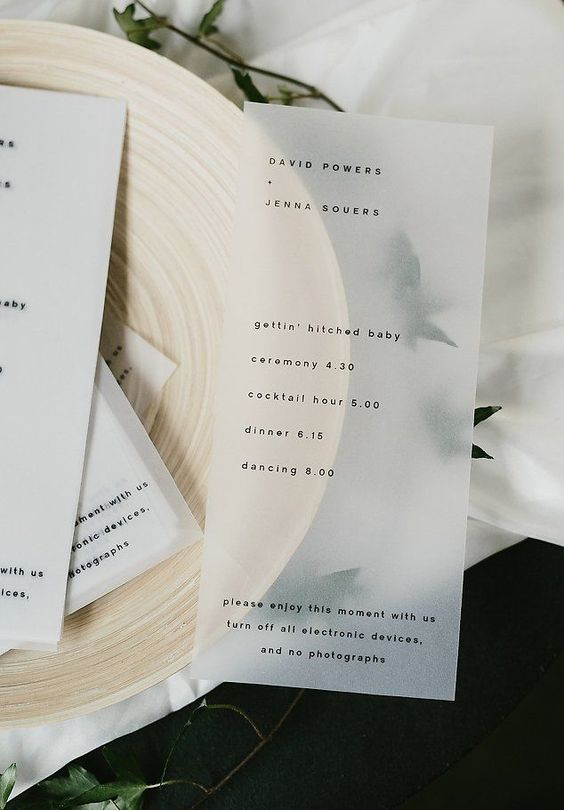 a minimalist opaque vellum wedding program is a chic idea for a modern wedding