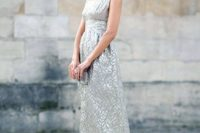 26 a sleeveless midi dress in silver grey with a print and a scoop neckline, a little silver clutch and dusty pink shoes