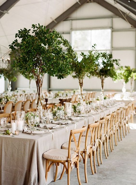 tall greenery centerpieces and matching greenery runners for a fresh spring look