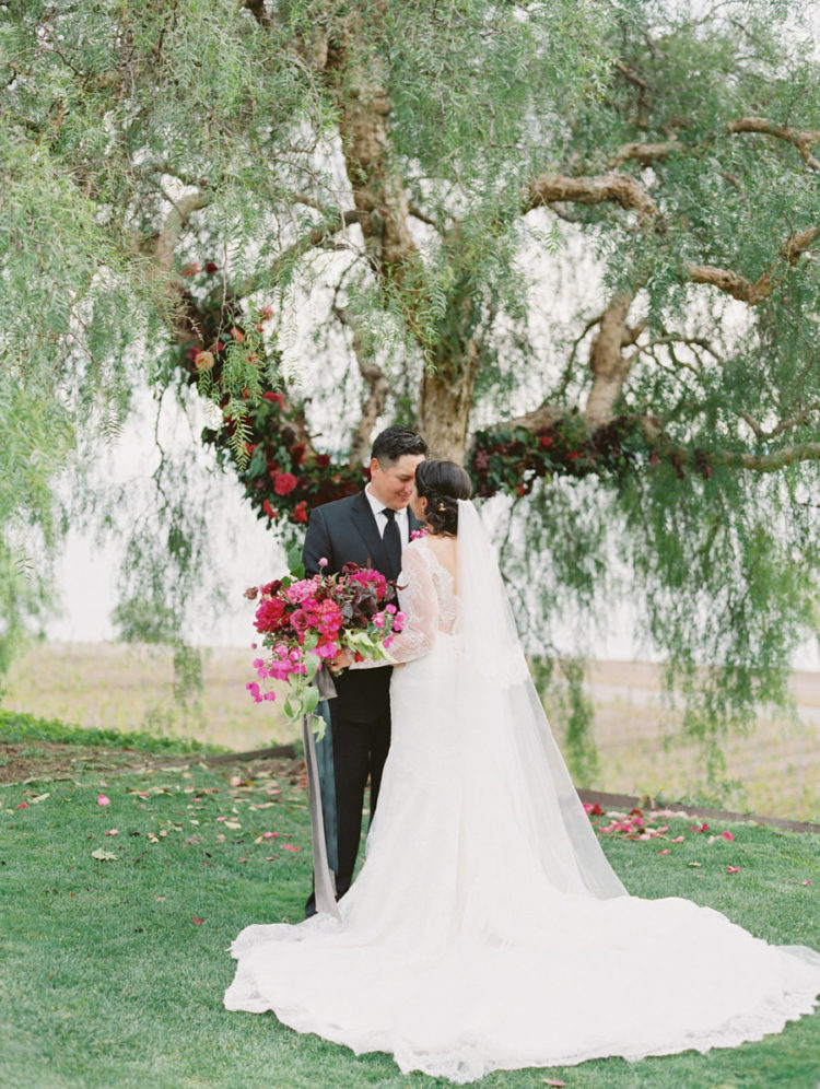 This beautiful wedding at a vineyard was done with rich colors and some black touches for drama