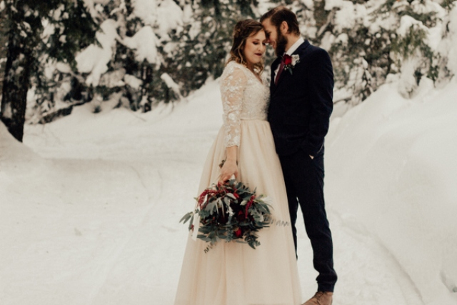 This wedding shoot is inspired by a winter forest and features a moody color palette, which is a very trendy idea