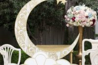 02 1920s inspired gold patterned crescent moon wedding backdrop with lush florals and refined chairs