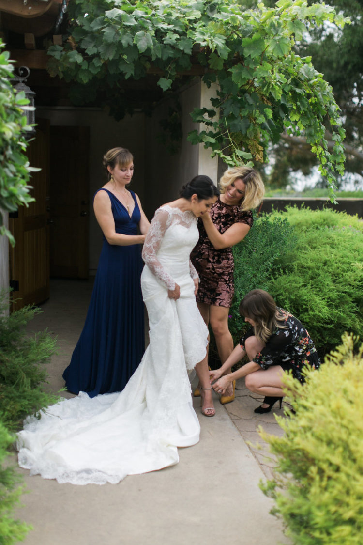The bride was wearing a chic illusion neckline wedding dress with illusion sleeves and back plus a train