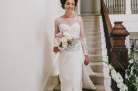 02 The bride was wearing a gorgeous wedding dress with an illusion neckline and sleeves and a dramatic side slit
