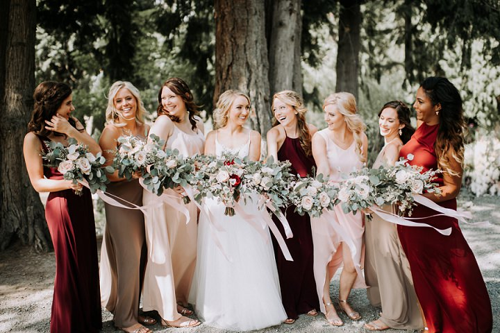 The bridesmaids were wearing neutral and burgundy maxi dresses as there was no color scheme