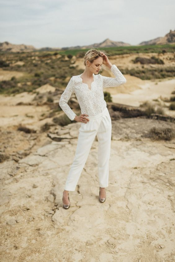 a bridal jumpsuit with a lace bodice and long sleeves and plain pants plus metallic heels