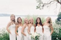 02 strapless white jumpsuits with a geometric neckline is a trendy and chic choice for a modern wedding