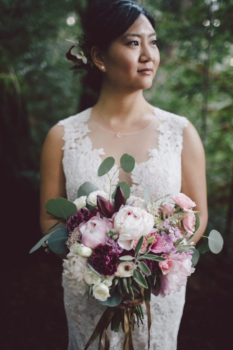 Her bouquet was done with light pink, blush and purple blooms and greenery that were also seen in the bouquet