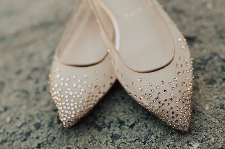 She finished her look with crystal-embellished nude flats by Christian Louboutin
