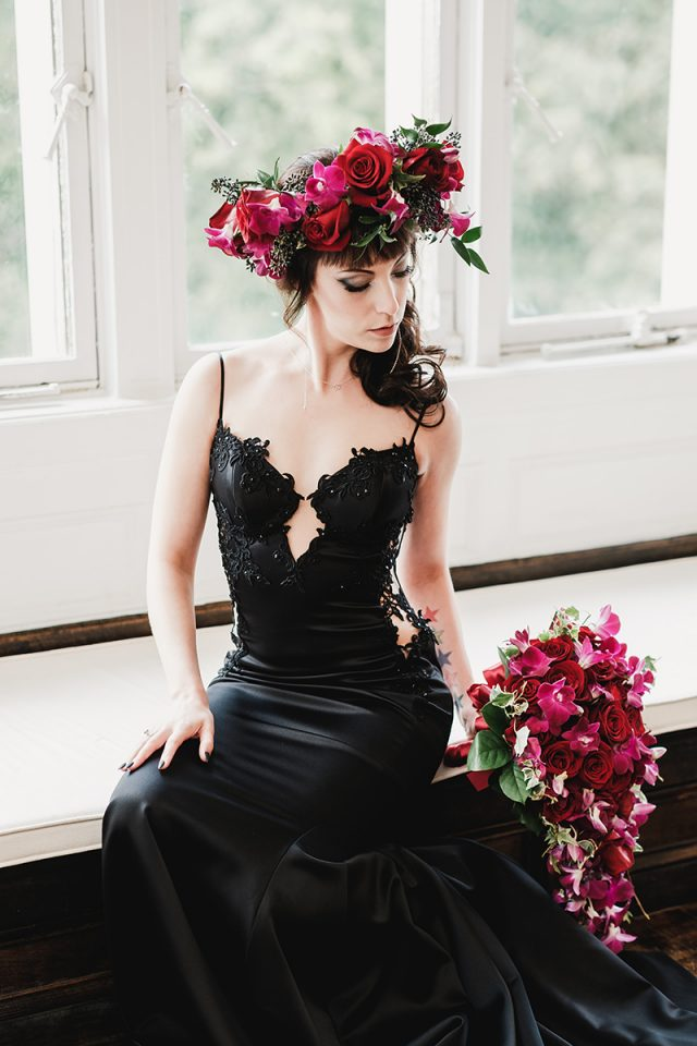 She was rocking a cascading purple and red bouquet and a matching flower crown