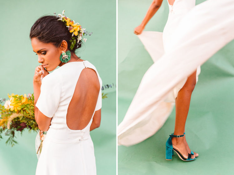 The back of the dress was cutout and the bride was rocking emerald velvet ankle strap shoes