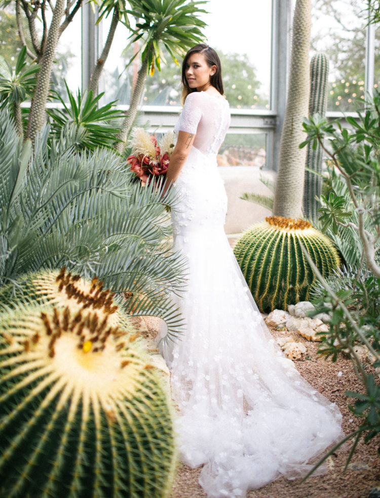 The bride was wearing a chic white mermaid wedding dress with floral appliques, an illusion back and neckline