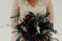 03 The bride was wearing an embellished wedding dress with a V-neckline, long sleeves and illusion detailing