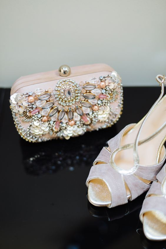 lavender-colored retro wedding shoes and a blush heavily embellished wedding clutch with peals and rhinestones