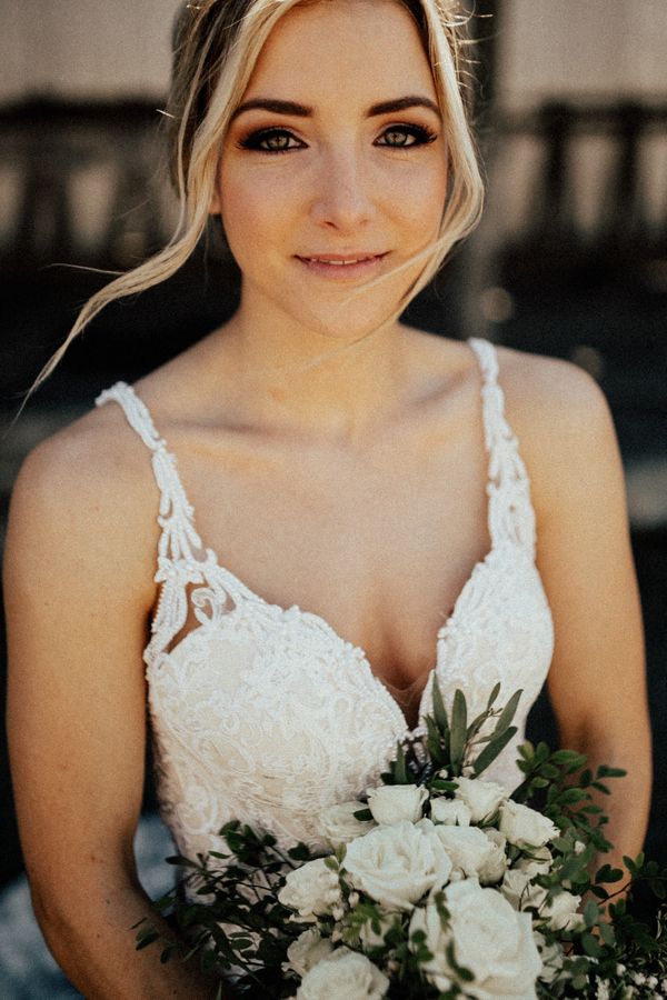The bride was rocking a gorgeous strap lace wedding dress with an embellished plunging neckline