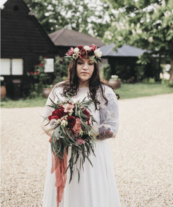 The bride was wearing a lush floral crown and carrying a matching bouquet