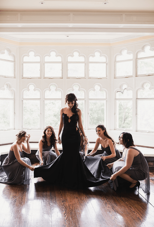The bridesmaids were wearing grey one shoulder and strapless gowns