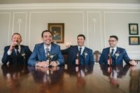 04 The groom and groomsmen were wearing three-piece blue suits and printed ties