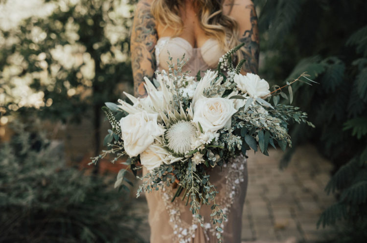 The wedding bouquet was done in creamy tones with greenery to make the dress stand out