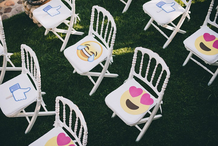 There were fun and colorful emoji props on the guests' chairs to make the wedding exit unforgettable