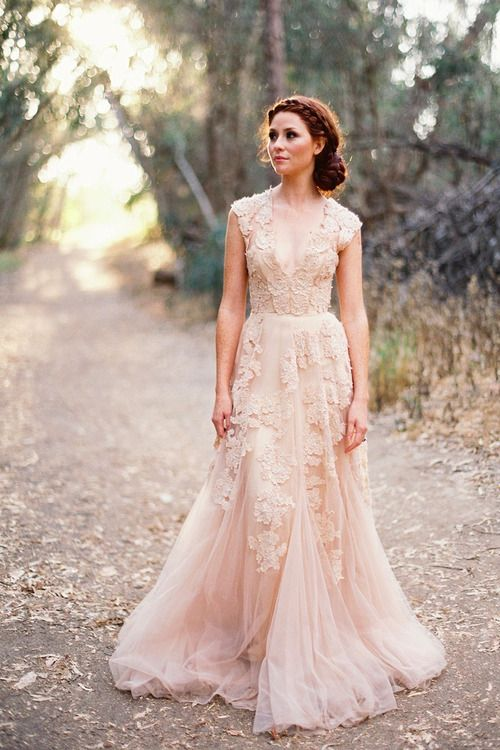 a blush wedding dress with floral lace appliques, a V-neckline, cap sleeves and an A-line silhouette