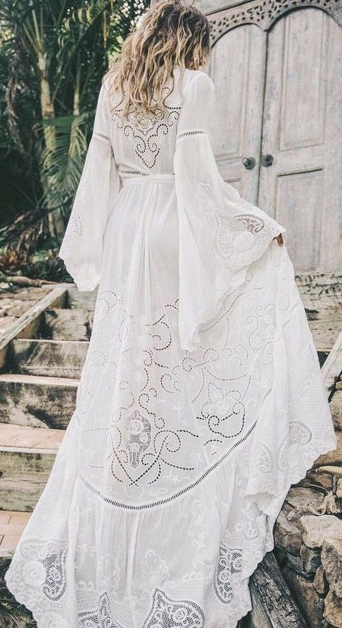 a creamy white embroidery boho maxi wedding dress with bell sleeves