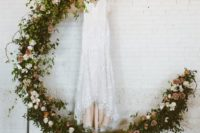 04 a dreamy crescent moon wedding arch made fully of greenery and fresh blooms is a gorgeous idea