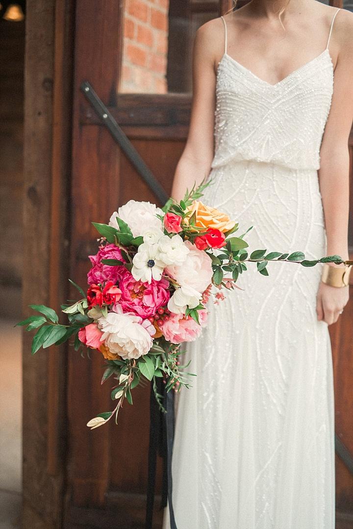 a gorgeous all-sparkling sheath wedding dress with a V-neckline and spaghetti straps