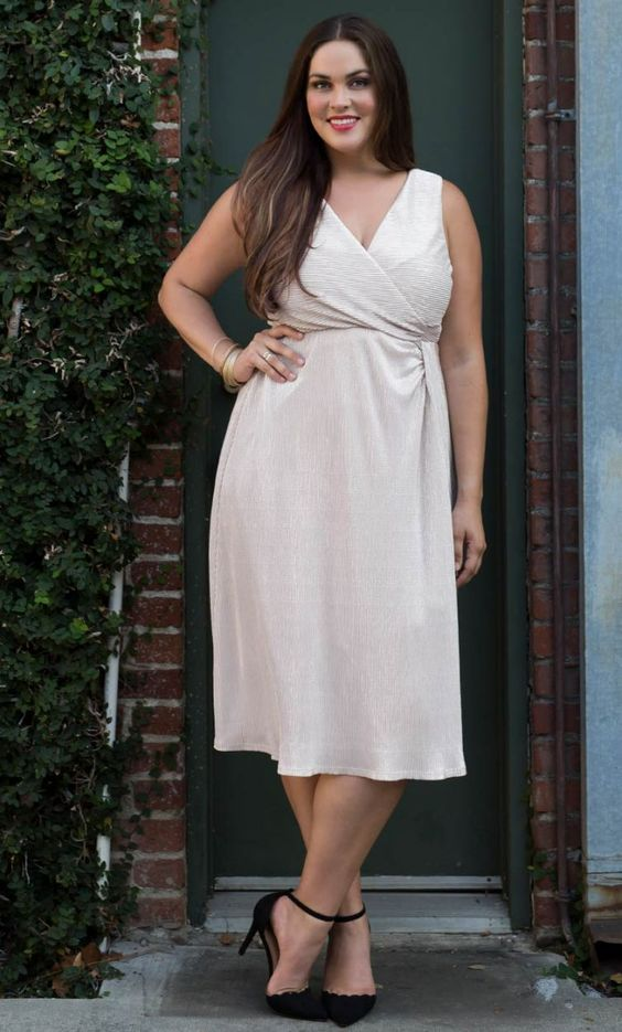 a sparkly creamy midi dress with wide straps, a deep V-neckline to wear with black strap heels