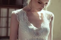 04 a very delicate bead and pearl bridal sash that matches the bodice detailing creates a more chic look