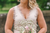 05 The bridesmaids were wearing blush wide strap gowns with a lacey neckline