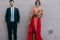 05 a fiery red spaghetti strap wedding dress with a front slit, an asymmetrical skirt and a train