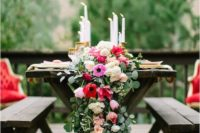 05 a lush greenery and pink and red flower table runner with candles for a refined tablescape