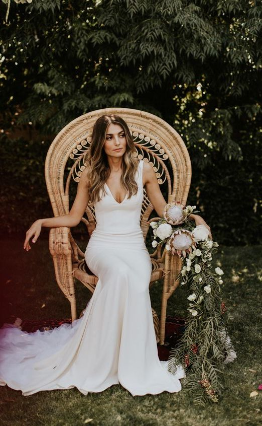 a modern mermaid wedding dress with thick straps, a long train of a plain fabric looks very sexy