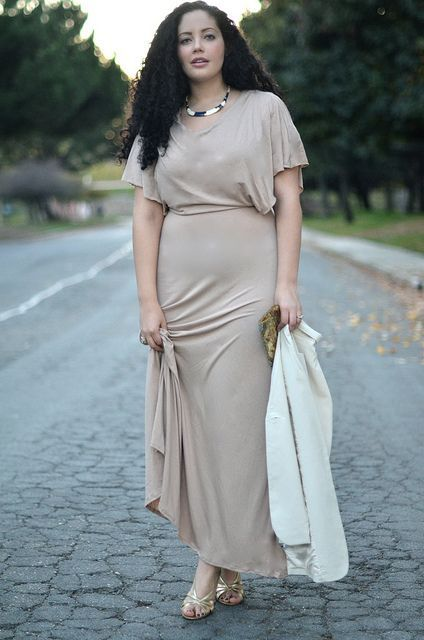 a neutral maxi dress with short sleeves and some statement accessories