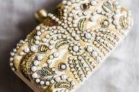 05 a whimsy art deco inspired wedding clutch with gold beads, vintage detailing and pearls for a pretty touch