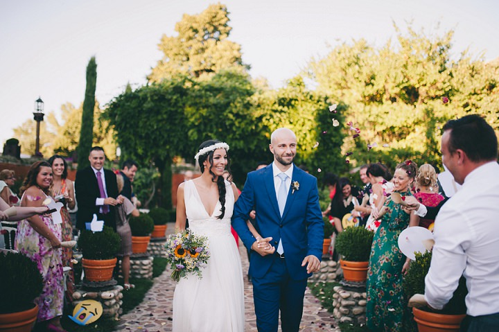 The groom was wearing a blue suit with a light blue tie
