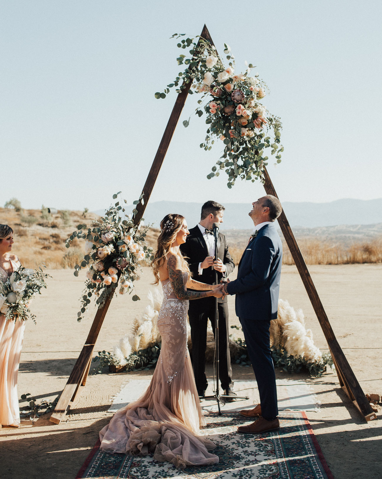 The groom was wearing a navy suit, brown shoes and a rose gold tie