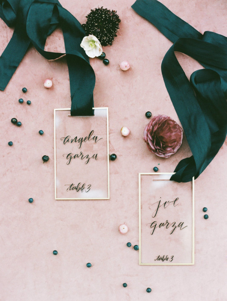These were chic escort cards of clear acryl with black calligraphy and black ribbons