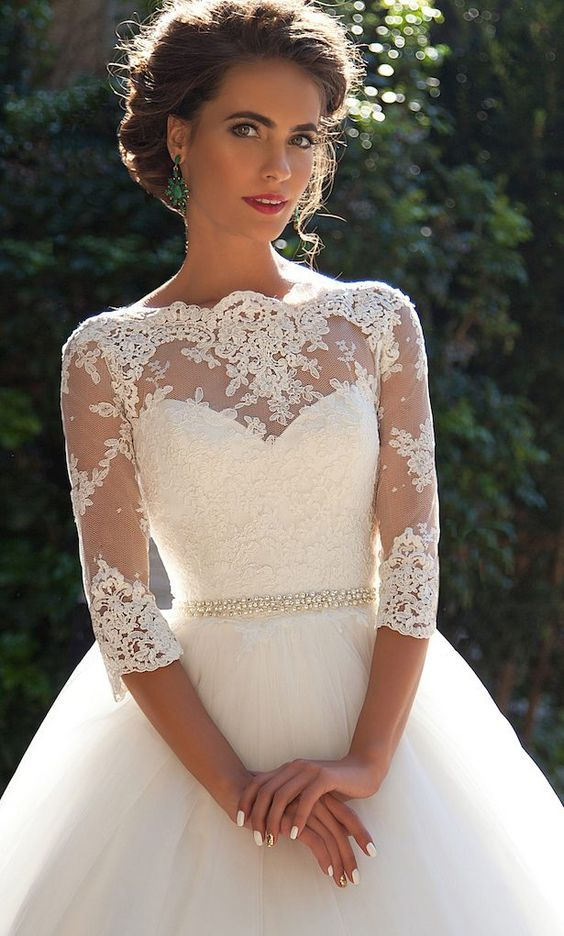 a delicate pearl bridal sash adds an elegant touch and chic to the outfit