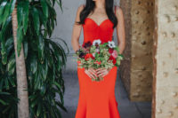 06 a fiery red mermaid wedding dress with a sweetheart neckline, buttons and a train for a catchy look