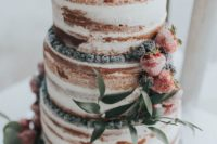 06 a naked wedding cake topped with sugared berries and blooms is ideal for a summer boho wedding