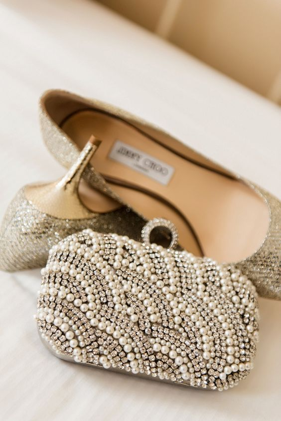 a sophisticated rhinestone and pearl wedding clutch and sparkly Jimmy Choo shoes