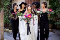 06 mismatching black jumpsuits and lacey black heels for all the bridesmaids